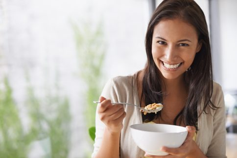 A lovely young woman enjoying a healthy salad